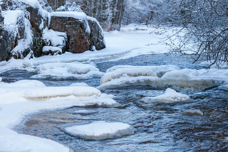 Winter landscape with rocks and a frozen river