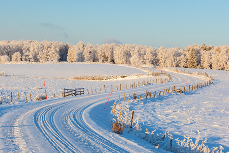 Curvy Country road in winter with snow Stock Photo