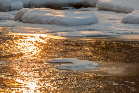 Sunlight in the river in winter