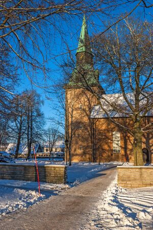 Church in a town during the winter Stock Photo
