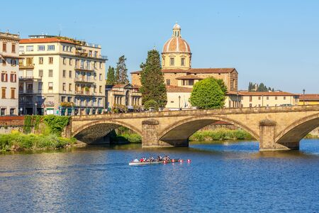 Sculling boat on the river Arno in Florence