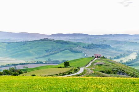 Farm on a hill in a valley of the a rural landscape