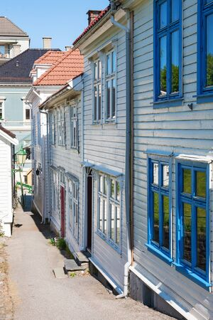 urban idyll: Alley with old wooden houses