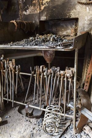 forge: Forge with a hearth and old pliers in a workshop