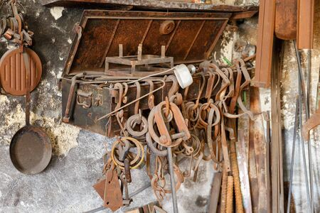 ancient blacksmith: Old forged parts in a workshop