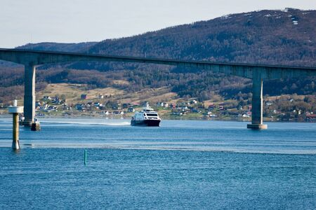 waterscapes: Bridge over the bay and a ferry under the bridge Stock Photo