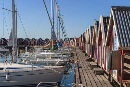 Marina with sailboats and storage huts