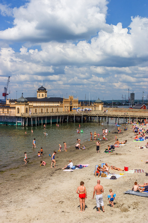 sweden resting: People who bathe at the beach at the bathhouse in Varberg, Sweden
