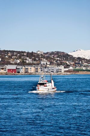 Fishing boat at the coast outside Tromso in Norway Stock Photo