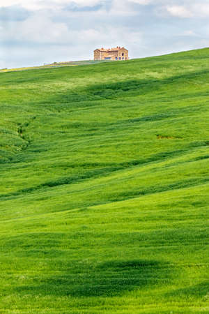 val: Grass field with a big house on the hill