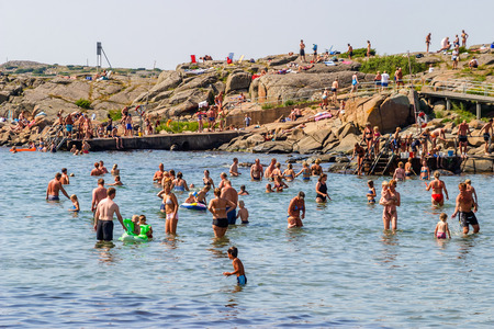 a bathing place: People bathing in the sea on the holiday Stock Photo
