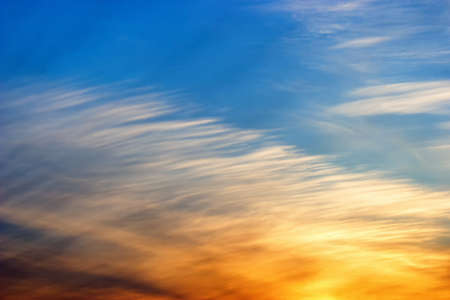 Beautiful sunset with feather clouds