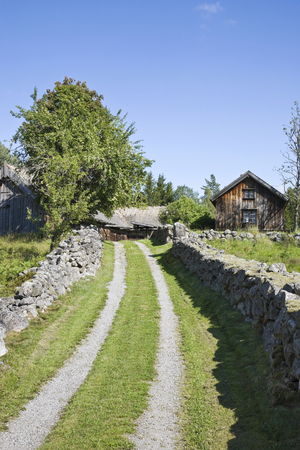Old farm with stone walls around the winding road