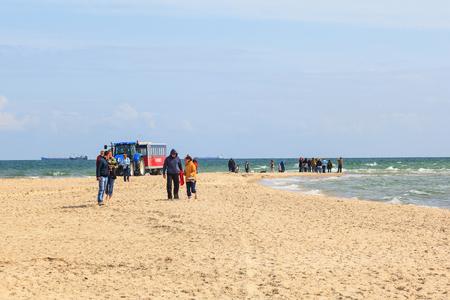 Tourists walking on the beach at Skagen in Denmark