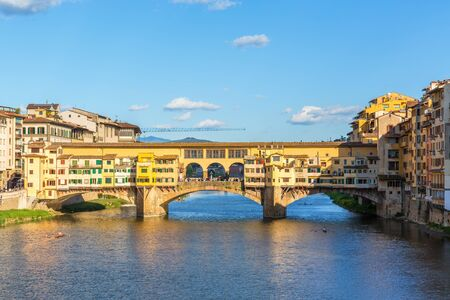 Ponte Vecchio bridge with canoes on the River Arno in Florence Editorial