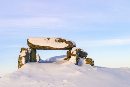 Luttra passage grave on a hill in wintertime