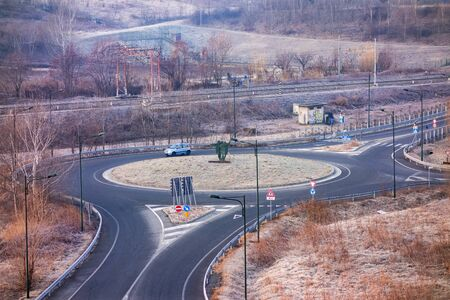 Roundabout with one car and a railroad