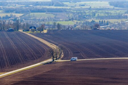 Rural landscape view with a RV car on a road