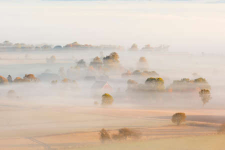 Morning fog over the fields in the countryside