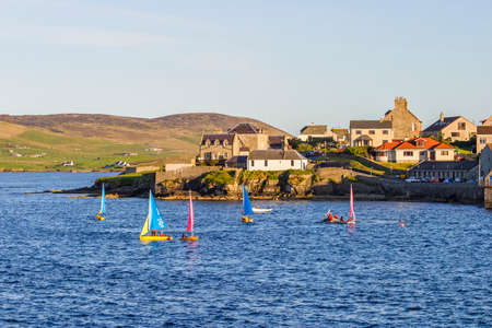 Sailboats in the bay at the city of Lerwick in Shetland
