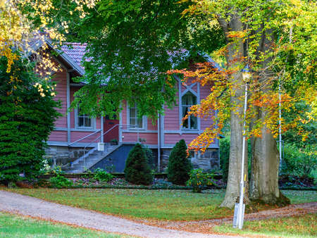 Pink picturesque cottage by the woods Banco de Imagens