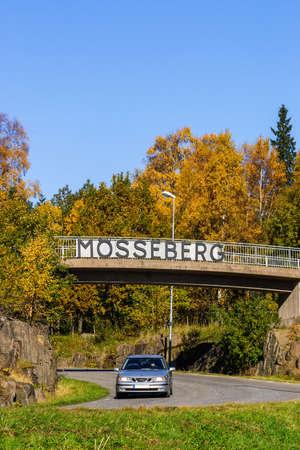 Car driving under a bridge on a road