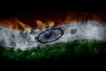 Indian flag with smoke isolated on dark black background 版權商用圖片