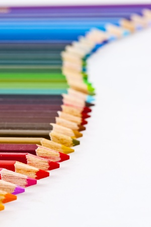 multi coloured: Colorful pencils curve line white isolated background