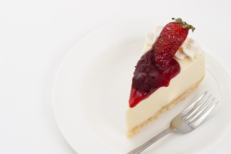 Strawberry Cheesecake on plate and white background photo