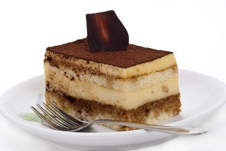 Tiramisu cake on the plate over white background