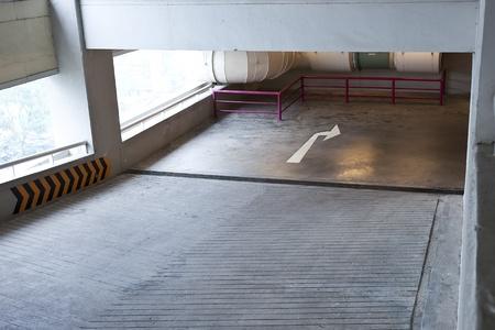 upper floor: ramp lane from upper floor to lower floor in car parking lot