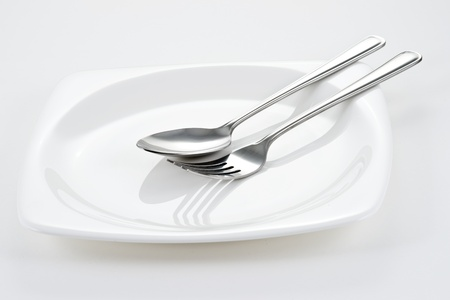 Fork and Spoon on white dish Stock Photo - 11380364