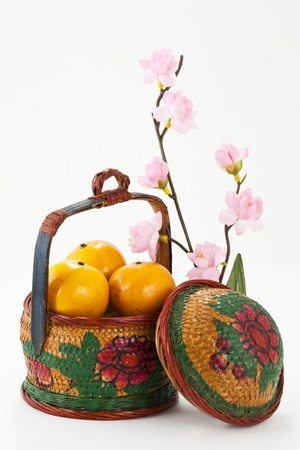 Oranges in Vintage basket with flower and Blessing word photo