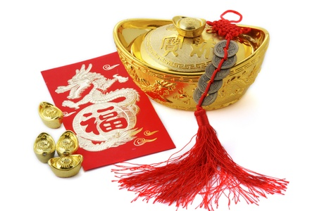 chinese new year dragon: Blossom word with copper coins and gold ingots Stock Photo