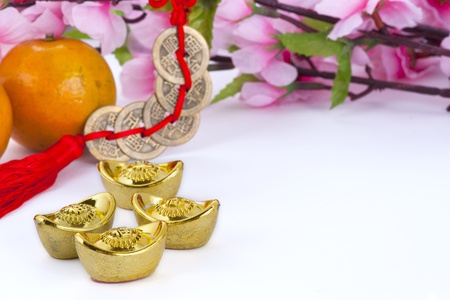 Gold ingots and copper coins with oranges and plum blossom