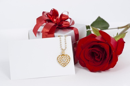 Diamond heart shape pendant and red rose photo