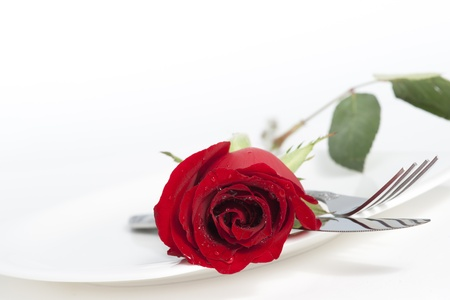 Valentine Series, Red rose and cutlery on white plate Standard-Bild