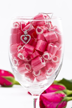 Valentine Series, Diamond pendant and candy with rose on white background photo