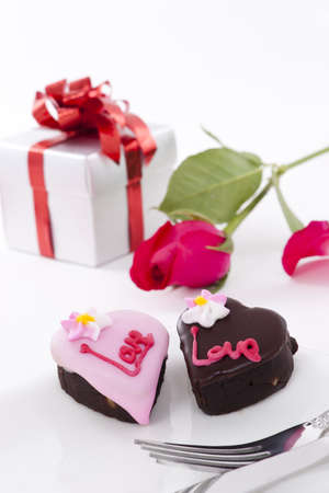 Valentine Series, Heart Shape Chocolate with rose on white background photo