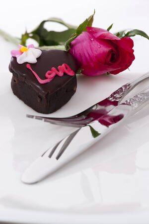 Valentine Series, Heart Shape Chocolate with rose on white background Stock Photo - 12292803