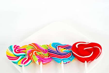 lolli: Heart shape Swirl  lollipop on white background
