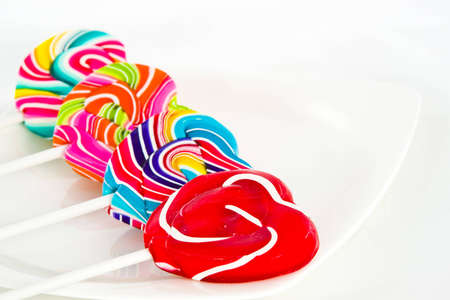 Heart shape Swirl  lollipop on white background photo