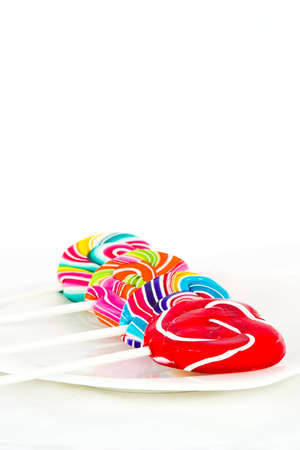Heart shape Swirl  lollipop on white background Stock Photo - 12742835