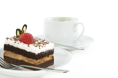 Piece of chocolate cake with strawberry decorate on top and cup of coffee  photo