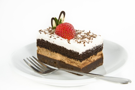 Piece of chocolate cake with strawberry decorate on top photo