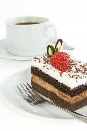 Piece of chocolate cake with strawberry decorate on top and cup of coffee  Stock Photo - 13177135