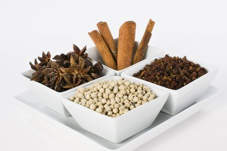 Star Anise, Cinnamon, White Pepper and Coriander Seed in Ceramic Bowl on White Background Stock Photo - 13736868