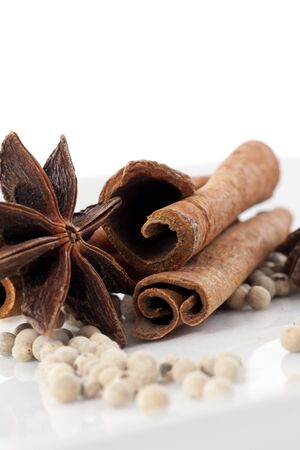 Star Anise, Cinnamon and White Pepper on White Background photo