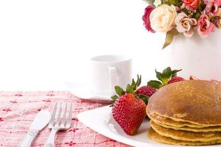 Pancake and strawberry have maple syrup on top with coffee Stock Photo - 13828375