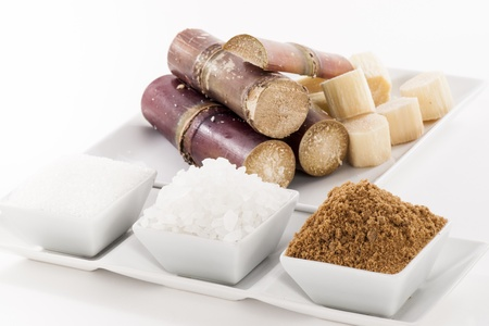 White, Rock, Brown Sugar in bowl and sugar cane photo